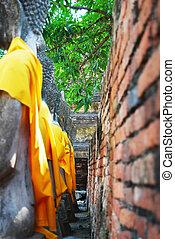 art of behind ancient statue, ayuttaya, thailand