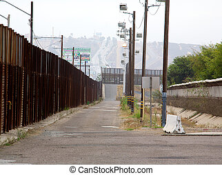 Border Fence - Large metal fence at the border between...
