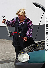 Curiosity - Chubby blond woman is trying to repair her car...