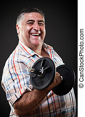 Happy fat man with dumbbell - Portrait of a happy fat man...