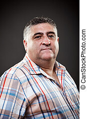 Fat man posing in studio - Portrait of a fat man posing in...