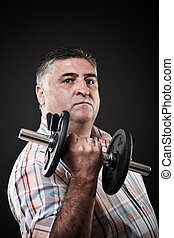 Serious fat man with dumbbell - Closeup portrait of a fat...