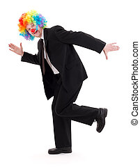 Happy business man with clown wig