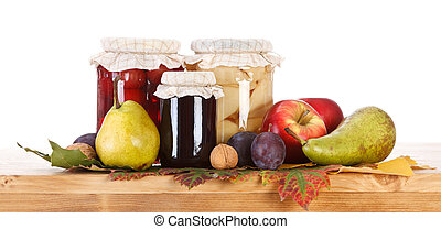 Fruit preserves - Compotes and jam in glass bottle with...