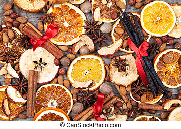 Christmas spices with dry orange and apple slices