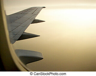 A view through the window of an airplane wing