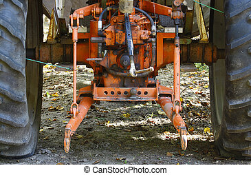 The back of an old orange farm tractor