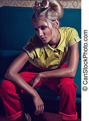 Close-up Portrait of blond woman with fashionable hairstyle....