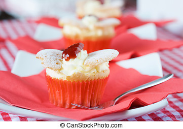 Delicious cupcake with whipped cream