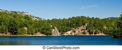 Canoe on a blue lake