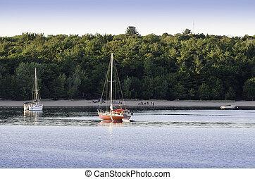 Two anchored sailboats
