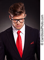 business man looking down - closeup picture of a young...