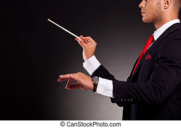 conductor business man - side view of a young business man...