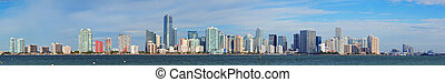 Miami skyline panorama in the day with urban skyscrapers and...