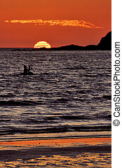 boat in the sunset of madagascar - sunset near a mountain in...
