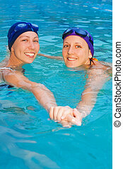 two girl swimmers in the pool