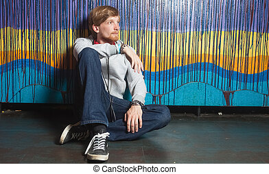Portrait of young man in cool location