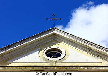 Detail of an old church and the cross