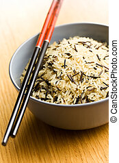 wild rice in ceramic bowl and chopsticks - the wild rice in...