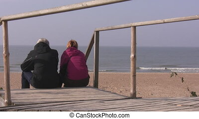 A senior couple relaxing - Rear view of senior man and woman...
