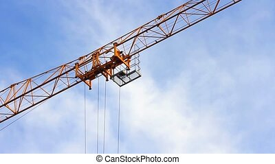 Topless tower crane - Details of the jib of a yellow...