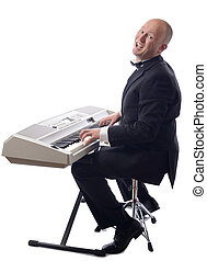 tuxedo playing keyboard - man in tuxedo playing keyboard