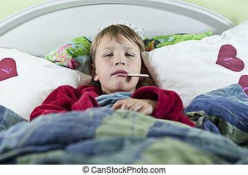 Boy in bed with the flu - Young caucasian boy in bed with...