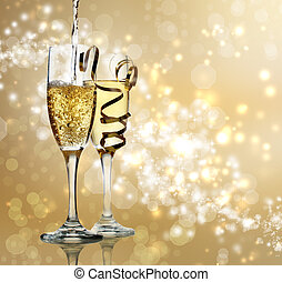 Champagne Celebration - Two champagne flutes on gold shiny...