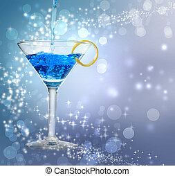 Blue cocktail - Blue cocktail being poured into a glass on...