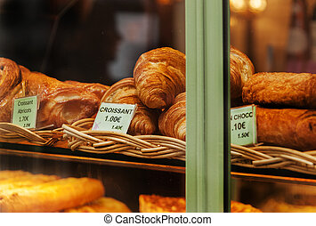 Croissants in bakery window in France