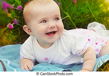 Portrait of very happy smiling baby, Cute crawling baby