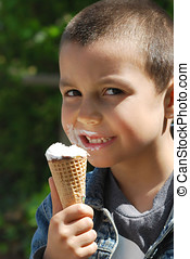 ice cream boy - close-up of young boy eating ice cream cone
