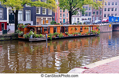 Houseboat in Amsterdam canal - Precious wooden houseboat...