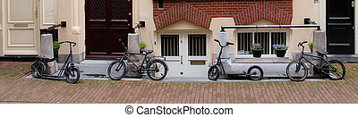 Small bikes on a street of Amsterdam - Small decorative...