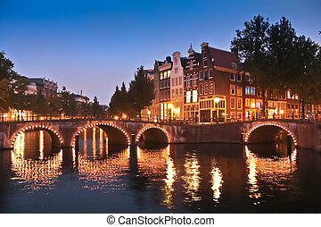 Amsterdam canals and bridges at night