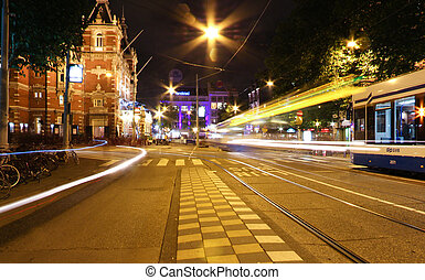 Amsterdam Leidseplein plaza at night - Tram stopped in...