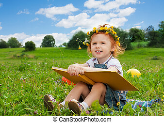 cute girl smiling holding book - funny little girl reading...
