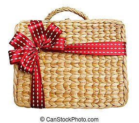 A gift box in a basket on white background
