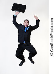 jump for joy - business man jumping in the air with a large...