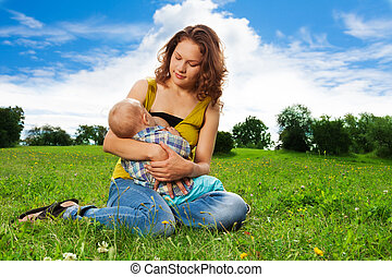 baby breastfeeding - woman breastfeeding her little son