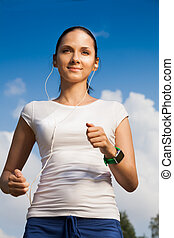 confident runner with headphones - portrait of confident...