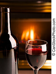 Fireplace red wine - A bottle of red wine infront of a...