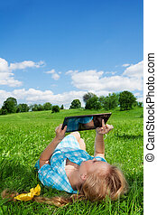 summertime countryside activities - pretty blonde girl...