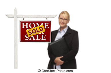 Businesswoman Behind Sold Home For Sale Real Estate Sign...