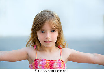 Blond kid girl open arms in outdoor