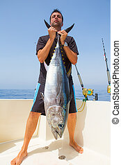 big Bluefin tuna catch by fisherman on boat trolling posing...