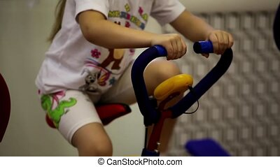 exercise bike - child on exercise bike