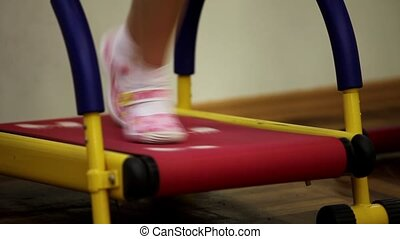 treadmill - child running on the treadmill in a fitness
