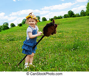 happy girl with horse stick - happy girl playing with horse...
