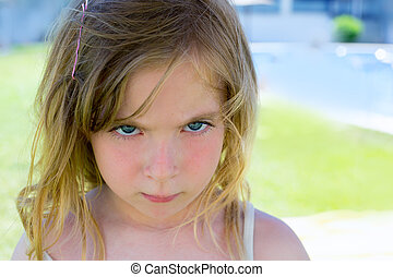 Angry blond children girl portrait looking camera - Angry...